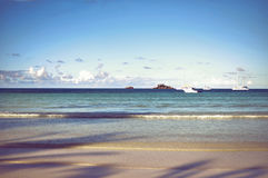 Seychelles Praslin island seascape with calm ocean and yachts Stock Photography