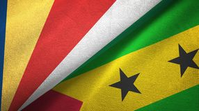 Seychelles and Sao Tome and Principe two flags textile cloth, fabric texture. Seychelles and Sao Tome and Principe two folded flags together royalty free illustration