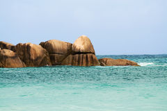 Seychelles seascape. Granite stones and ocean. Anse Takamaka Stock Photography