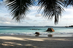 Seychelles seascape. Granite stones, palm and ocean. Anse Lazio Stock Photography