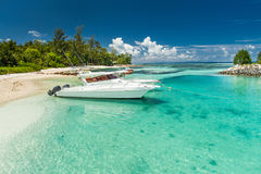 Seychelles. Crystal clear water and boat Royalty Free Stock Photo