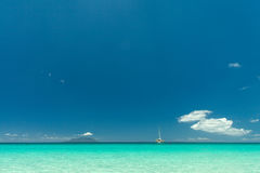 Seychelles. Transparent turquoise water and blue sky on the background Royalty Free Stock Photos