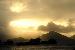 Seychelles. The sun sets behind the island. Stock Photography
