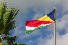 Seychelles waving flag on sky background Royalty Free Stock Photos
