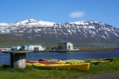 Seydisfjordur Kayaks. Colorful kayaks lining the shore at Seydisfjordur in Iceland's East Fjords Stock Image