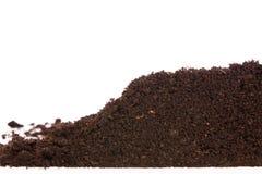 Sezione della sporcizia o del suolo isolata su fondo bianco fotografie stock