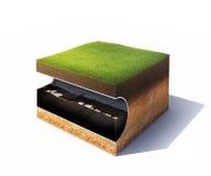 Sezione trasversale di terra con erba ed il tubo d'acciaio isolati su bianco Fotografie Stock Libere da Diritti