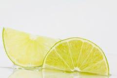 Sezioni del limone affettato Fotografia Stock