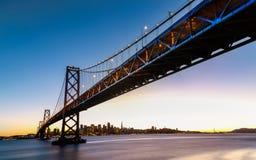 SF Bay Bridge at Sunset. San Francisco-Oakland Bay Bridge and cityscape at sunset Stock Images