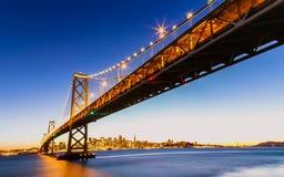 SF Bay Bridge at Sunset. San Francisco-Oakland Bay Bridge and cityscape at sunset Royalty Free Stock Images