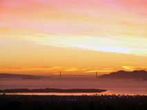 SF East Bay sunset_Golden Gate. Sunset photo taken from the East Bay hills, across the San Francisco Bay, California. The Golden Gate Bridge is located at the Stock Image
