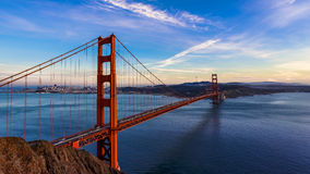 SF Golden Gate Bridge at sunset. San Francisco Golden Gate Bridge and cityscape at sunset royalty free stock photo