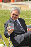 SF mayor Ed Lee looks at a piece of rebar. Royalty Free Stock Photography