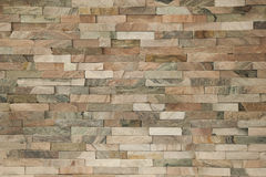 Sfałszowana kamiennej ściany tła ceglana tapeta Obrazy Stock