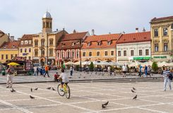 Sfatului Place at Brasov, in Romania. In heart of Middle Age quarter, Sfatului Place is the last place for witches burn. Now, it is a quiet space with stores royalty free stock images