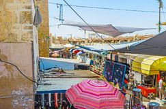 The souk in Sfax, Tunisia. SFAX, TUNISIA - SEPTEMBER 3, 2015: The large chaotic market souk stretches along the medieval city walls, its stalls offer wide range Stock Photo