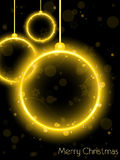 Sfera al neon dorata di natale sul nero Fotografia Stock Libera da Diritti