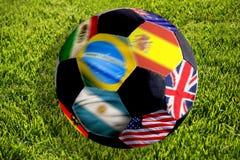 Sfera di calcio con le bandierine Fotografie Stock