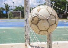 Sfera di calcio nell'obiettivo Fotografia Stock Libera da Diritti