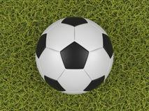 Sfera di calcio su una priorità bassa del campo di erba Fotografie Stock Libere da Diritti