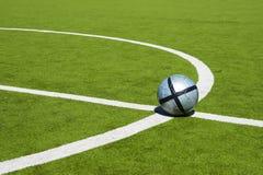 Sfera di calcio su una riga Immagini Stock Libere da Diritti