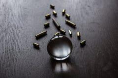 Sfera di cristallo con le cartucce Fotografie Stock