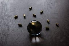 Sfera di cristallo con munizioni Fotografia Stock Libera da Diritti