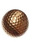 Sfera di golf dell'oro Immagini Stock