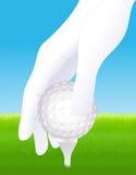 Sfera di golf della holding della mano Immagine Stock Libera da Diritti