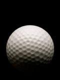 Sfera di golf sul nero Immagini Stock Libere da Diritti