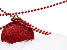 Sfera di natale con neve e la decorazione Fotografia Stock