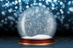 Sfera di vetro con neve da priorità bassa Fotografia Stock