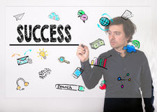Sfera differente 3d Scrittura dell'uomo d'affari con l'indicatore nero sulla rappresentazione Immagini Stock Libere da Diritti