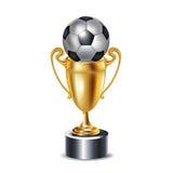 Sfera dorata di calcio e del trofeo Immagine Stock