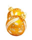 Sfera dorata per gli ornamenti. Immagine Stock