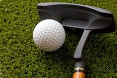 Sfera e bastone di golf Fotografie Stock