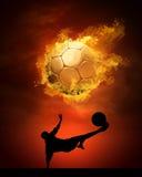 Sfera e fuoco di calcio Fotografia Stock