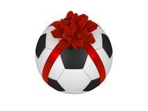 Sfera footbal di calcio con il nastro rosso di natale Fotografia Stock