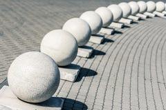 Sfere concrete su un marciapiede Immagine Stock Libera da Diritti