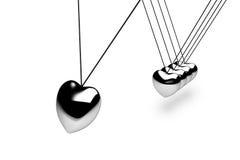 Sfere d'argento d'attaccatura del cuore Fotografie Stock