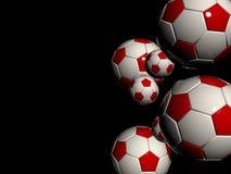 Sfere di calcio rosse bianche alla moda Fotografie Stock Libere da Diritti