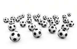 Sfere di gioco del calcio sopra priorità bassa bianca Fotografia Stock Libera da Diritti