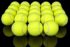 Sfere di tennis sul nero Fotografia Stock Libera da Diritti