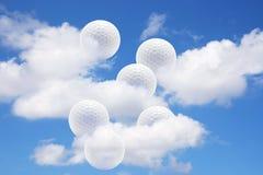 Sfere e nubi di golf Fotografia Stock Libera da Diritti