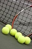 Sfere e racchetta di tennis Fotografia Stock