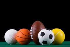Sfere miniaturizzate di sport   immagine stock