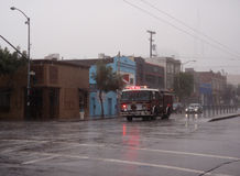 SFFD Fire Truck races down fourth street in rain Royalty Free Stock Image