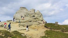 Sfinx et touristes Photo libre de droits