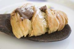 Sfogliatella stuffed with melted chocolate Stock Image