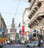 Sforza Castle. Dante street with Sforza Castle in the background, Milan, Italy. Dante street ia an importatnt street for shopping in Milan downtown. Sforza royalty free stock images